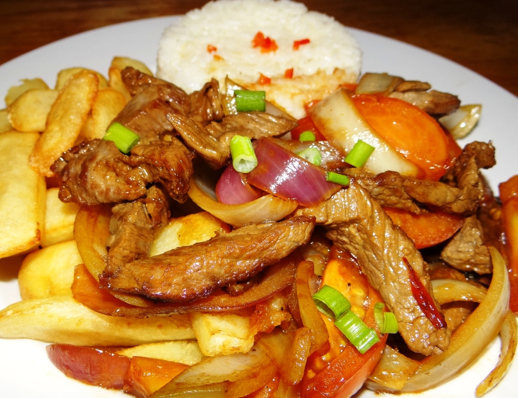 Enjoy our Lomo Saltado and a breathtaking Pisco Sour